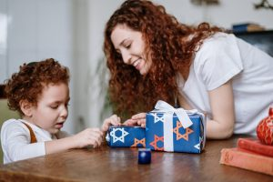 woman with son celebrating hanukkah